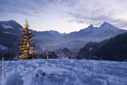 Leinwandbild Motiv Christmas tree in Berchtesgaden in front of mount Watzmann
