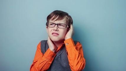 teenager boy migraine headache holding his head ten years in