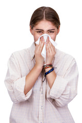 Woman covering her nose with a white tissue trying to escape the