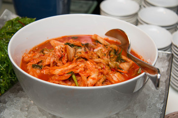 bowl of traditional Korean napa cabbage Kimchi.