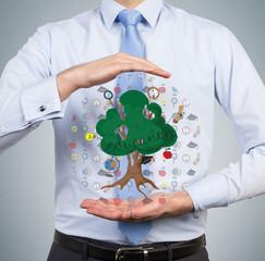 man holding education tree