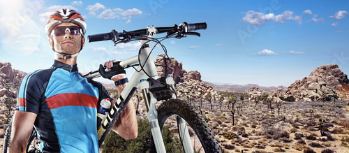 Sport. Cyclist carry a bike on sunny sky - 80684883