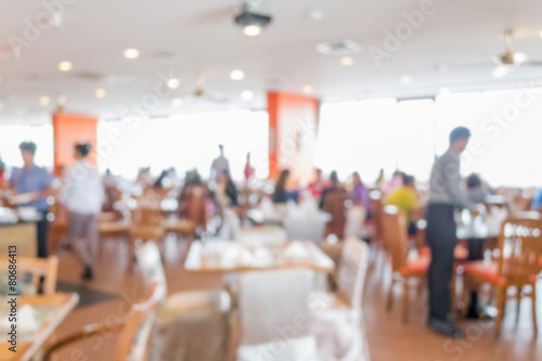 Blurred people in the cafeteria - 80686413