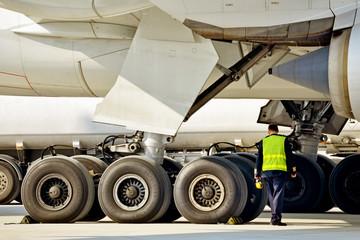 A crewman performing a pre-flight inspection