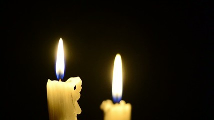 Candles and wind, blinking flame