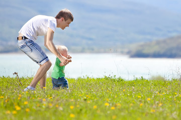 Father with son are playing in nature