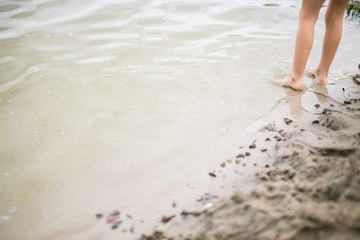 Toddler feet in water at the beach
