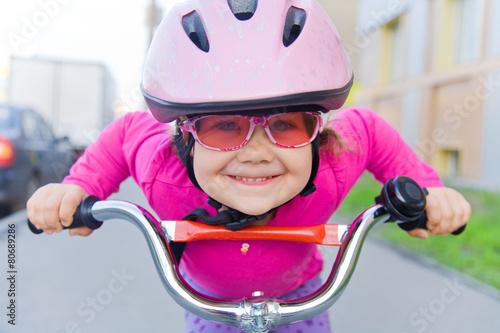 Leinwandbild Motiv girl on  bicycle
