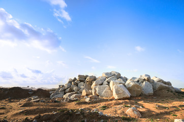 Barren landscape with hill of rock boulder stone