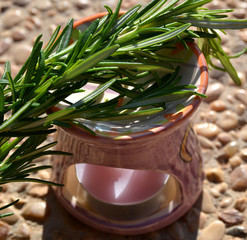 Aromatic lamp with branches of rosemary.
