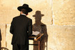 Leinwanddruck Bild - Religious orthodox jew praying at the Western wall in Jerusalem.