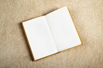 Vintage Book with Blank Pages on the Carpet Floor