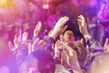 Fans Applauding To Music Band Live Performing on Stage
