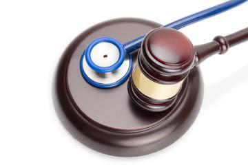 Judge gavel and stethoscope on white