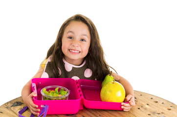 Cute little brunette girl with her healthy lunchbox