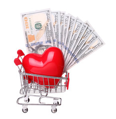 heart in shopping cart with cash concept isolated on white backg