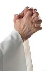mani giunte che pregano