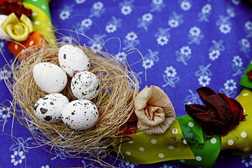 Easter decorative ring with cornhusk flowers and nest with eggs
