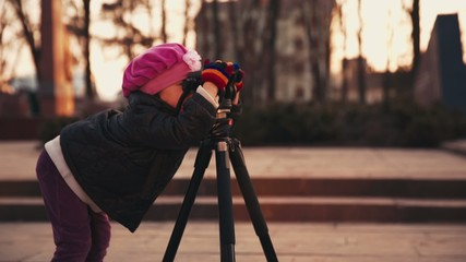 Girl is Photographing by Tripod