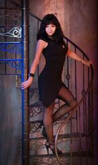 Elegant attractive woman in black dress.