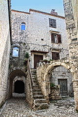 narrow street with stone arch