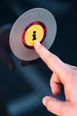 Hand pressing information button