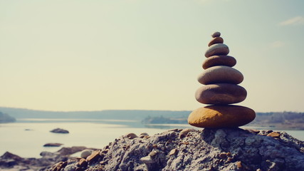 Pyramid of stones on a sand hill.