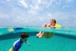Kids having fun swimming on summer vacation