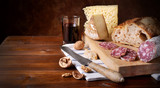 Cheese, salami, bread and red wine