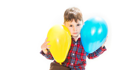 little boy with colorful balloons
