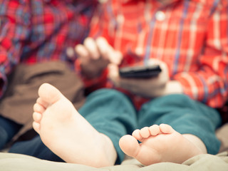 little boy feet with cell phone on background