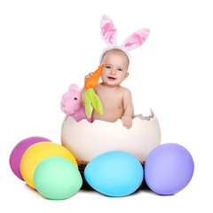 baby girl easter rabbit sitting in a giant easter egg