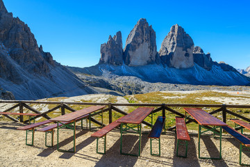 Tables with view of Tre Cime peaks in Dolomites Mountains, Italy