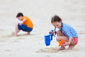 Two kids playing at beach