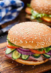 Bacon burger with vegetables and cutlet