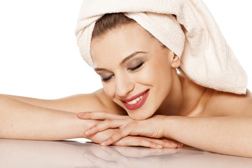 beautiful smiling woman with a towel on her head