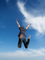 Girl jumping in the sky in freedom