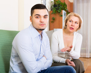 Woman explaining something to man