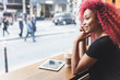 Leinwandbild Motiv Beautiful girl in a cafe talking on smart phone