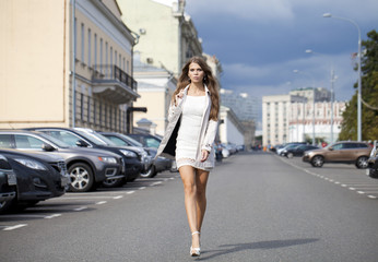 Young beautiful woman in white coat