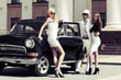 Young fashion people by retro car