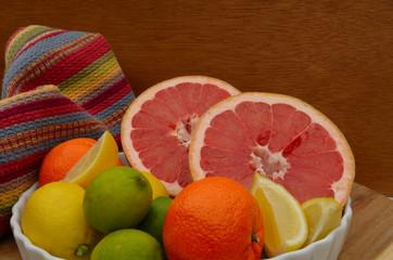 Bowl of citrus including grapefruit, orange, lemon and lime