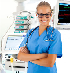 Female doctor with medical equipment on background