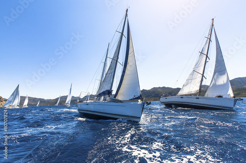 Aluminium Jacht Sailing in the wind through the waves at the Aegean Sea.