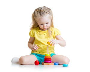 child playing with color pyramid toy