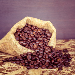 Coffee beans in a bag with filter effect retro vintage style