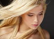 Portrait of blonde girl with fluttering hair - 80712001