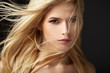 Portrait of blonde girl with fluttering hair - 80712008