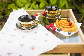 tea and roll with berries