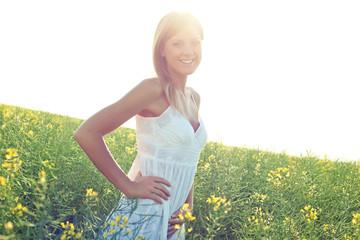 Happy woman in green field
